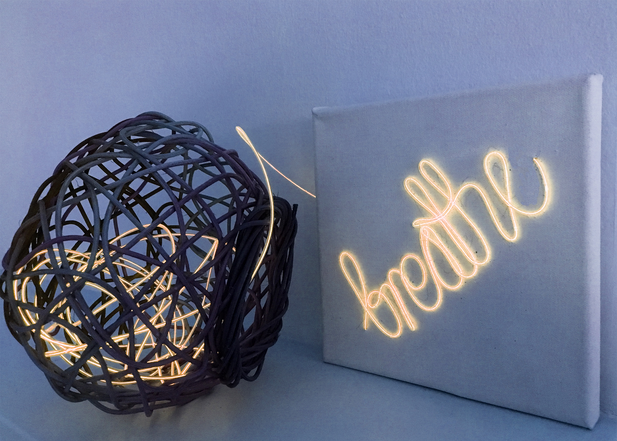"Photo of artwork ""Breathe"". Neon embroidery onto canvas."