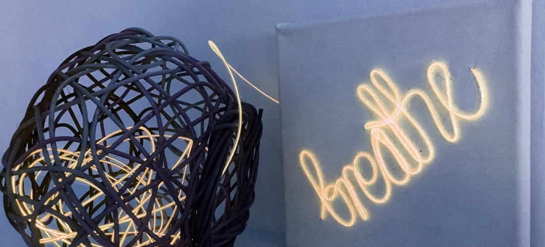 "Photo of artwork ""Breathe"". Neon embroidery onto canvas."
